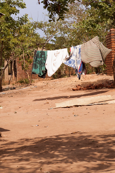Laundry hangs out to dry in a neighborhood, and while drying is no problem, keeping it clean from the flying dirt and sand in this wind is another issue.