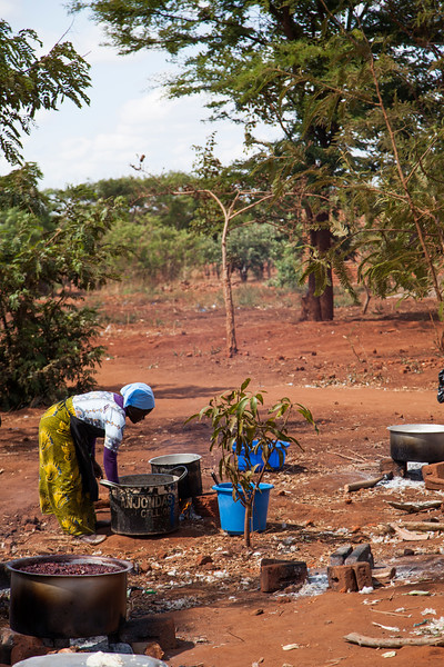 A church dedication is a big project in Malawi, and usually means the host church will feed everyone who comes from other areas. These ladies were hard at work hours before sunrise, cooking enough food to feed hundreds of people. This is their kitchen.
