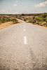 A pit stop on the highway to Jenda led to this glimpse of the road, lit by the harsh African sun.