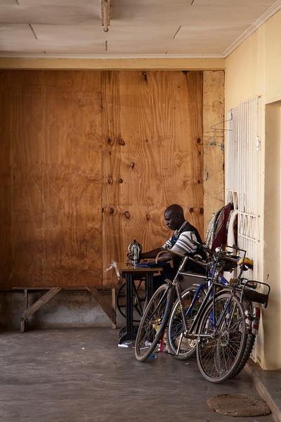A man runs a sewing machine alongside the public market in Mzuzu.