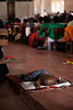 Babies sleep on the concrete floor of the church during the services, which can last as long as four hours at a stretch.
