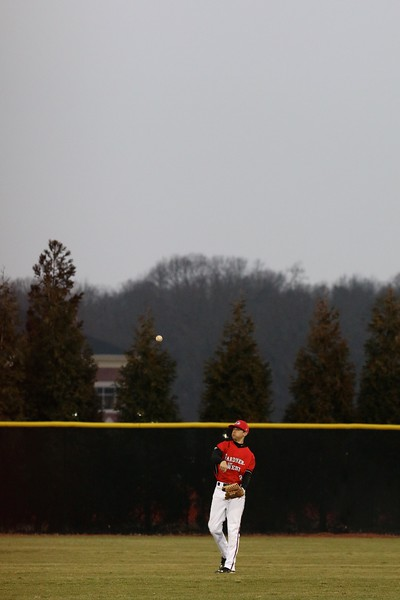 Baseball faces Holy Cross on a cold rainy day at home.