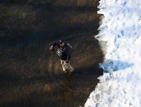 JOED VIERA/STAFF PHOTOGRAPHER- Burt, NY-A man gets ready to cast at Fisherman's Park . Thursday, March 12, 2015