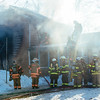 JOED VIERA/STAFF PHOTOGRAPHER- Middleport, NY-Firefighters fight a Lewiston Road house fire. Wednesday, March 11, 2015