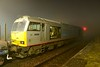 17 March 2015 :: 60099 was called to a stop at Barnetby to allow a passenger train to pass on a damp and foggy evening and stopped just long enough to make something of it.  The train is the 6E08 steel train from Wolverhampton to Immingham which had called at Scunthorpe to collect some new rails