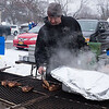 JOED VIERA/STAFF PHOTOGRAPHER- Olcott, NY-Peter Chiavetta cooks chicken during the annual Polar Bear Swim for Sight. Sunday, March 1, 2015