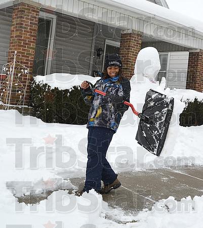 MET 030115 SNOW DAY DIGGING OUT CARTER MINNETT