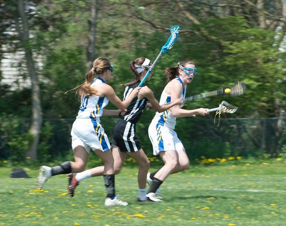 JOED VIERA/STAFF PHOTOGRAPHER-Lockport, NY-Lockport High School JV Girls Lacrosse takes on NIagara Wheatfield during Lockport's LAX Day.