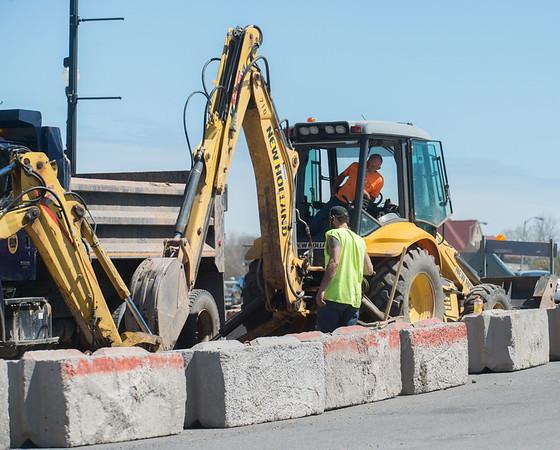 JOED VIERA/STAFF PHOTOGRAPHER-Lockport, NY- Crews work using an excavator on Main Street in front of City Hall.