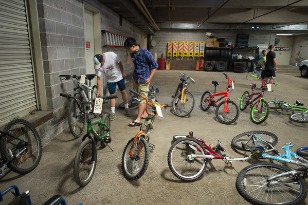 JOED VIERA/STAFF PHOTOGRAPHER-Lockport, NY- Attendees check out the selection of bikes at the Lockport Police Bicycle Auction.