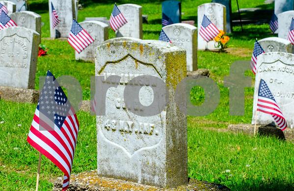MET 052415 HEADSTONES AND FLAGS