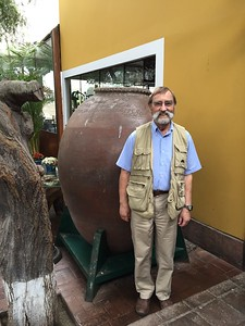 Myth member - Bill Dantzler next to large amphora - Erika Milam