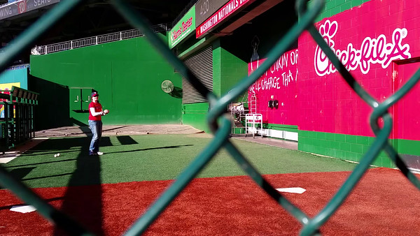Jenni pitches in the Nationals dugout