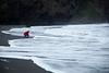 Kelsey takes a feel of the Tasman Sea on a treacherous shoreline at Whatipu.