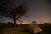 Camp rests quiet under a near-full moon on the shoreline near Waipu.