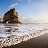 Arch Islands show off the beauty of nature's formations, just off the mainland at Wharariki Beach.