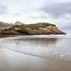 Arch Islands at Wharariki Beach sit peacefully after a fresh dumping of rain.