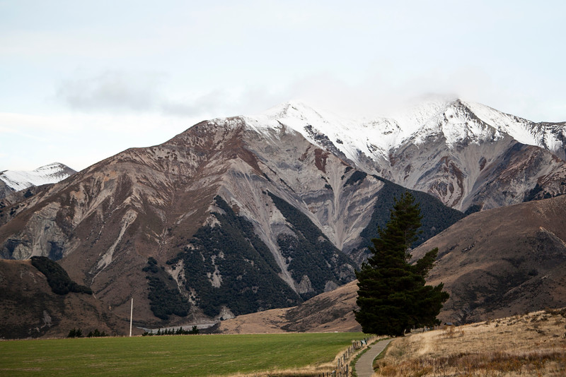 As the sun goes down, Castle Hill rests quiet under the snowy peaks surrounding.
