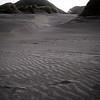Dune stretch into the distance near the shoreline at Wharariki Beach.