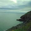 Riding the DART along the coast from Bray to Greystones.