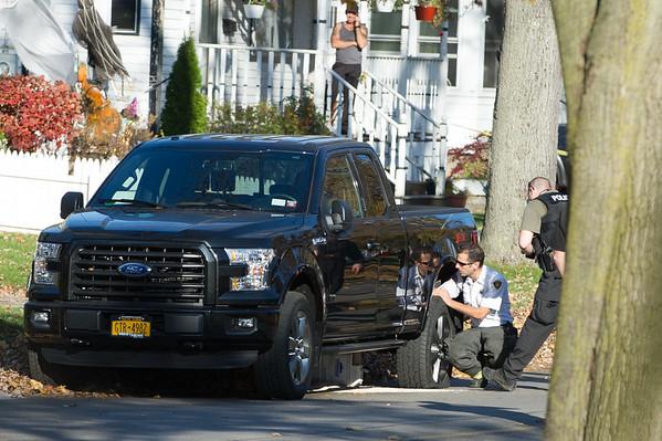 JOED VIERA/STAFF PHOTOGRAPHER Lockport, NY-Lockport City Police canvas the scene of a shooting on Walnut Street.