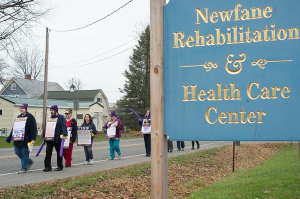 JOED VIERA/STAFF PHOTOGRAPHER Lockport, NY-Newfane Rehabilitation & Health Care Center Employees picket outside the center.