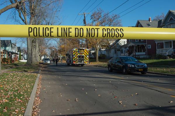 JOED VIERA/STAFF PHOTOGRAPHER Lockport, NY- A poline line blocks Walnut Street as Lockport City Police canvas the scene of a shooting.