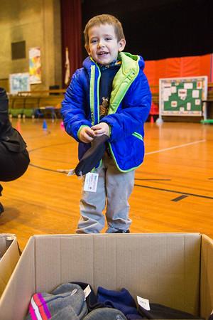 JOED VIERA/STAFF PHOTOGRAPHER Lockport, NY- Zachary Goff checks out his new coat.