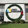 JOED VIERA/STAFF PHOTOGRAPHER Lockport, NY- First Niagara installs its holiday wreath at its Main Street branch.