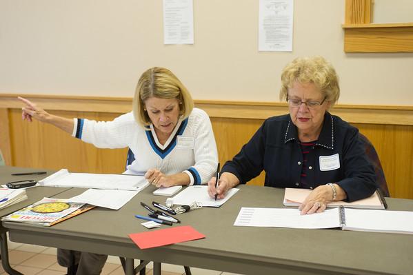 JOED VIERA/STAFF Lockport, NY-Darlene Taylor and Carol Gottman direct voters at the South Lockport Fire Company.