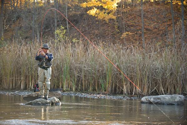 JOED VIERA/STAFF Burt, NY-Joe Taulane from Garnet Valley, PA attempts to reel in a fish at Fishermans Park.