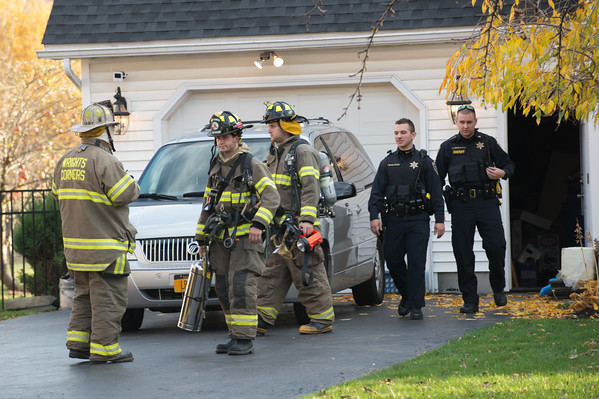 JOED VIERA/STAFF PHOTOGRAPHER Lockport, NY-Wrights Corners Fire Company works on extinguishing a fire at a home on 5666 Leete Road.