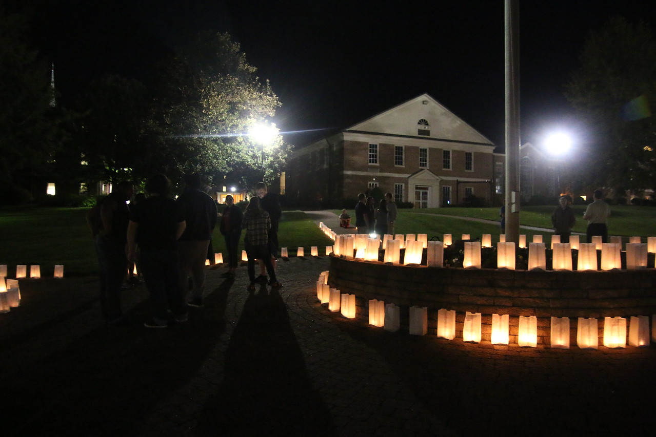 Students paying their respects to those who lost their lives from drunk driving incidents.