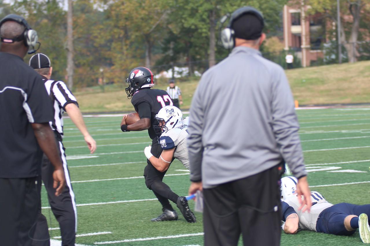 Charleston Southern football player tries to take down GWU quarterback Tyrell Maxwell.