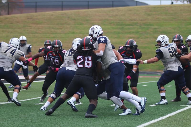 #26, line backer Aaron Cook battles Charleston Southern football player.