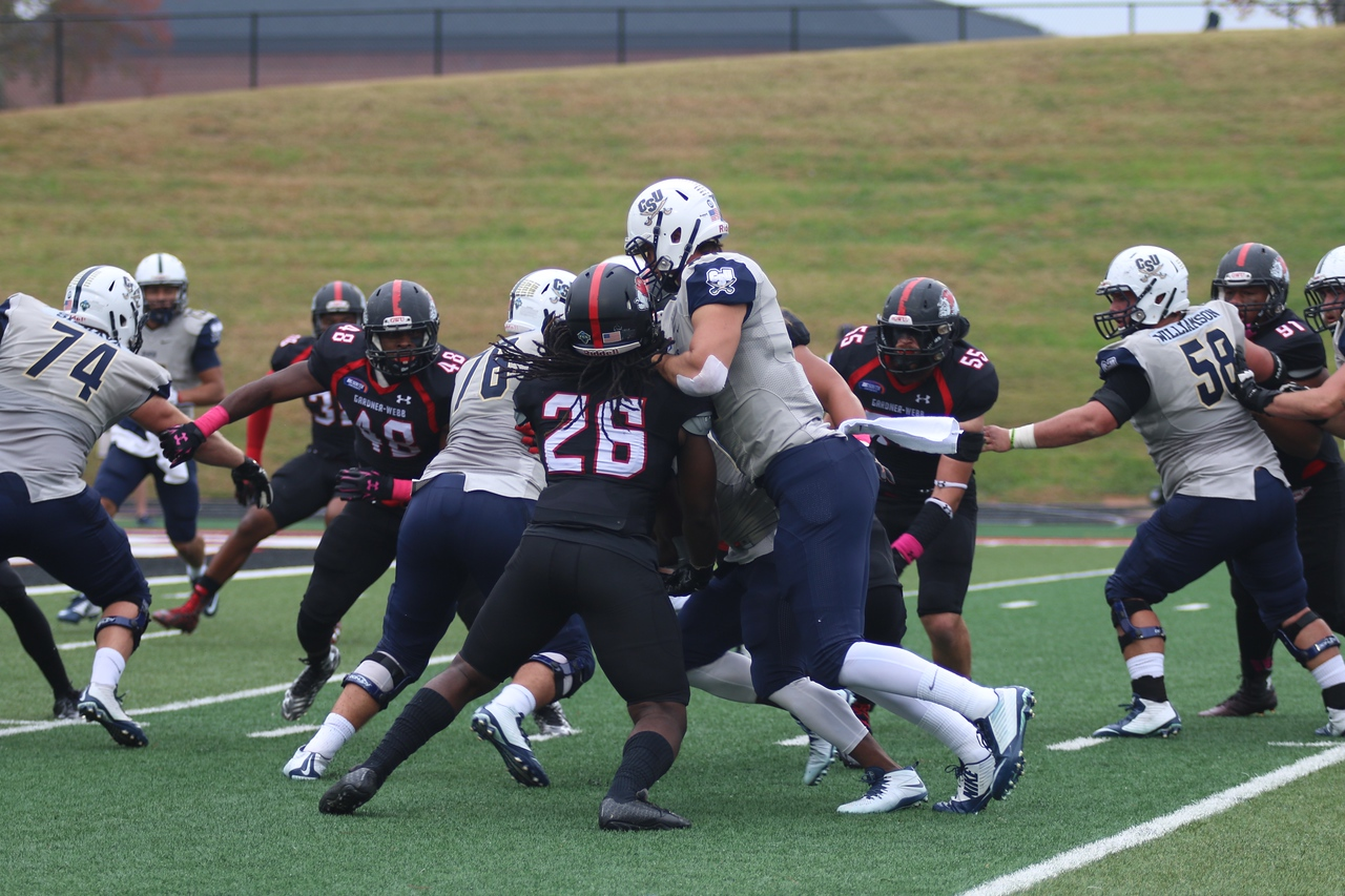 #26, line backer Aaron Cook battles Charleston Southern football player.