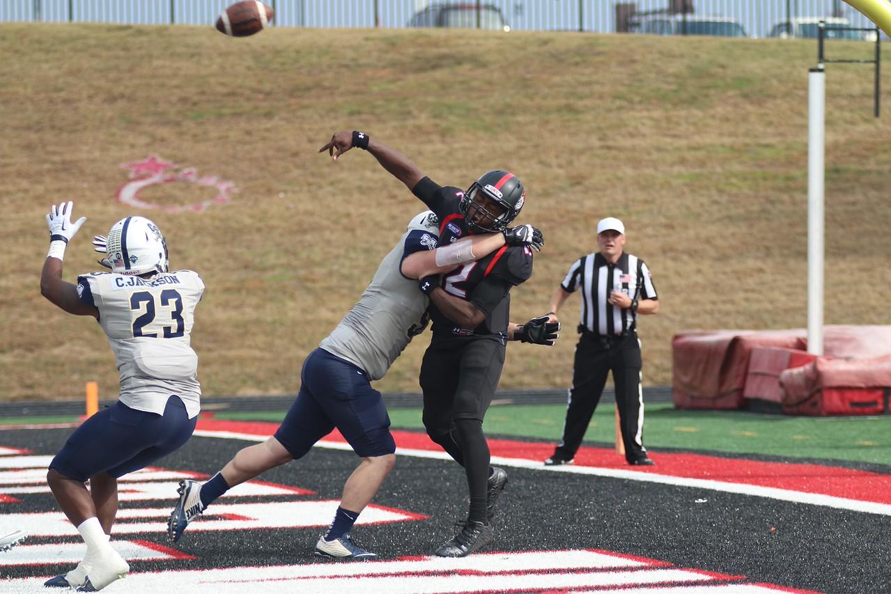 #12, quarterback Tyrell Maxwell throws the ball.