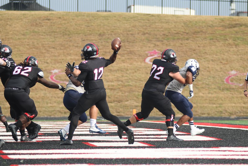 #12, quarterback Tyrell Maxwell throws the ball.