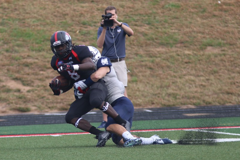 Charleston Southern football player tackles #8 Josh Bettistea.