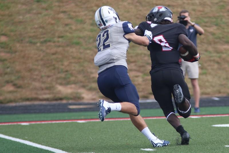 Charleston Southern football player tries to take down #8 Josh Bettistea.