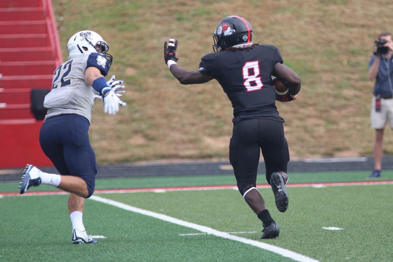 #8, running back Josh Bettistea takes off with the ball.