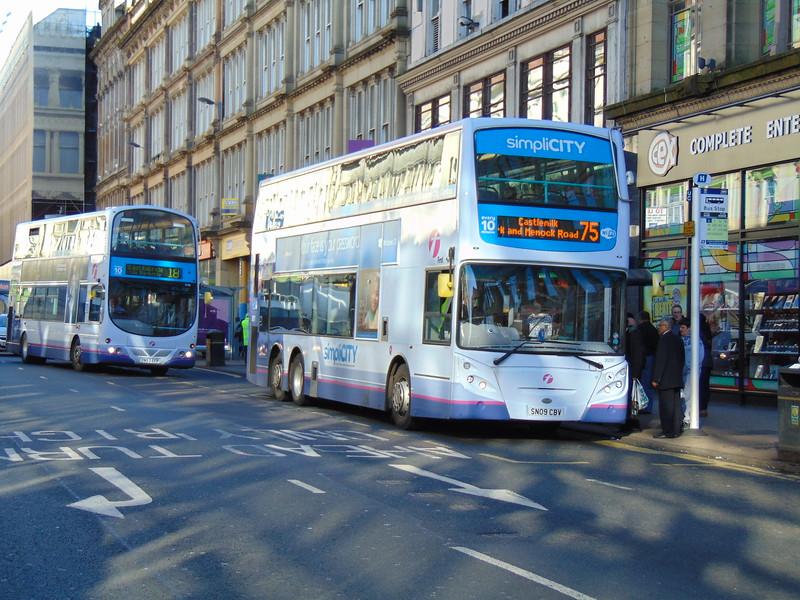 First tri-axle Enviro 500 SN09CBV 38207 in Glasgow on the 75 to Castlenilk.