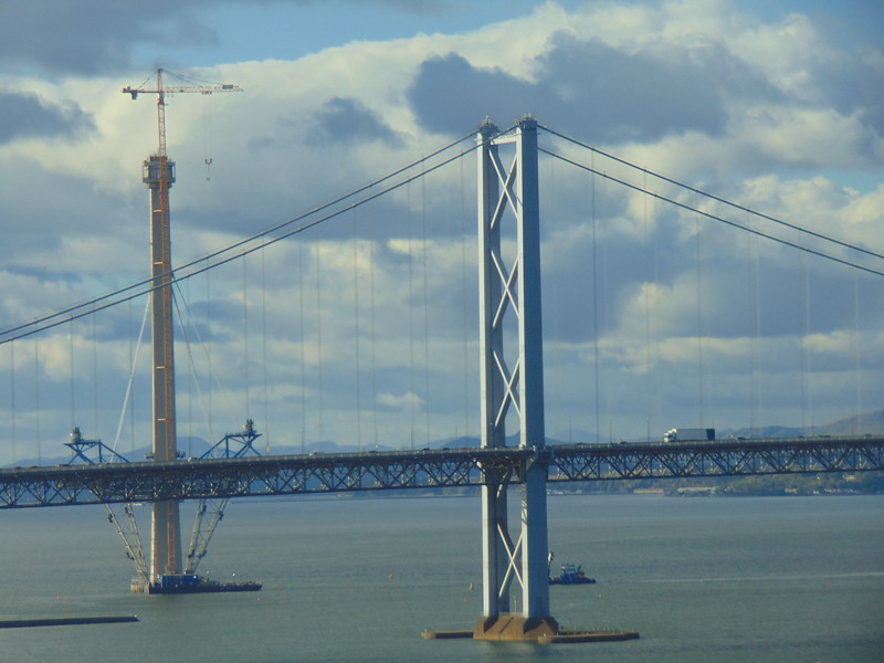 The Forth Road Bridge seen from the rail bridge with the new second/third Forth crossing seen behind.