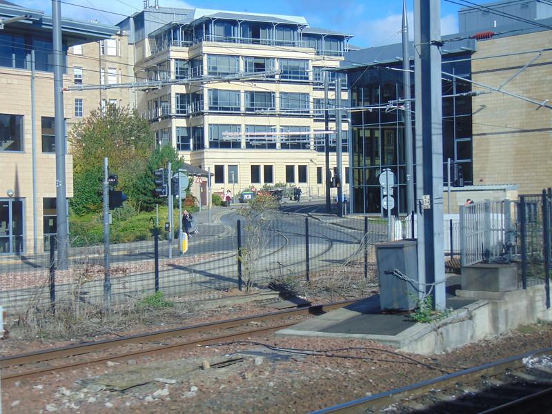 Edinburgh Trams leave the railway at Haymarket.