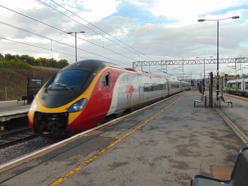 A Virgin Trains Class 390 Pendolino speeding through Milton Keynes Central.
