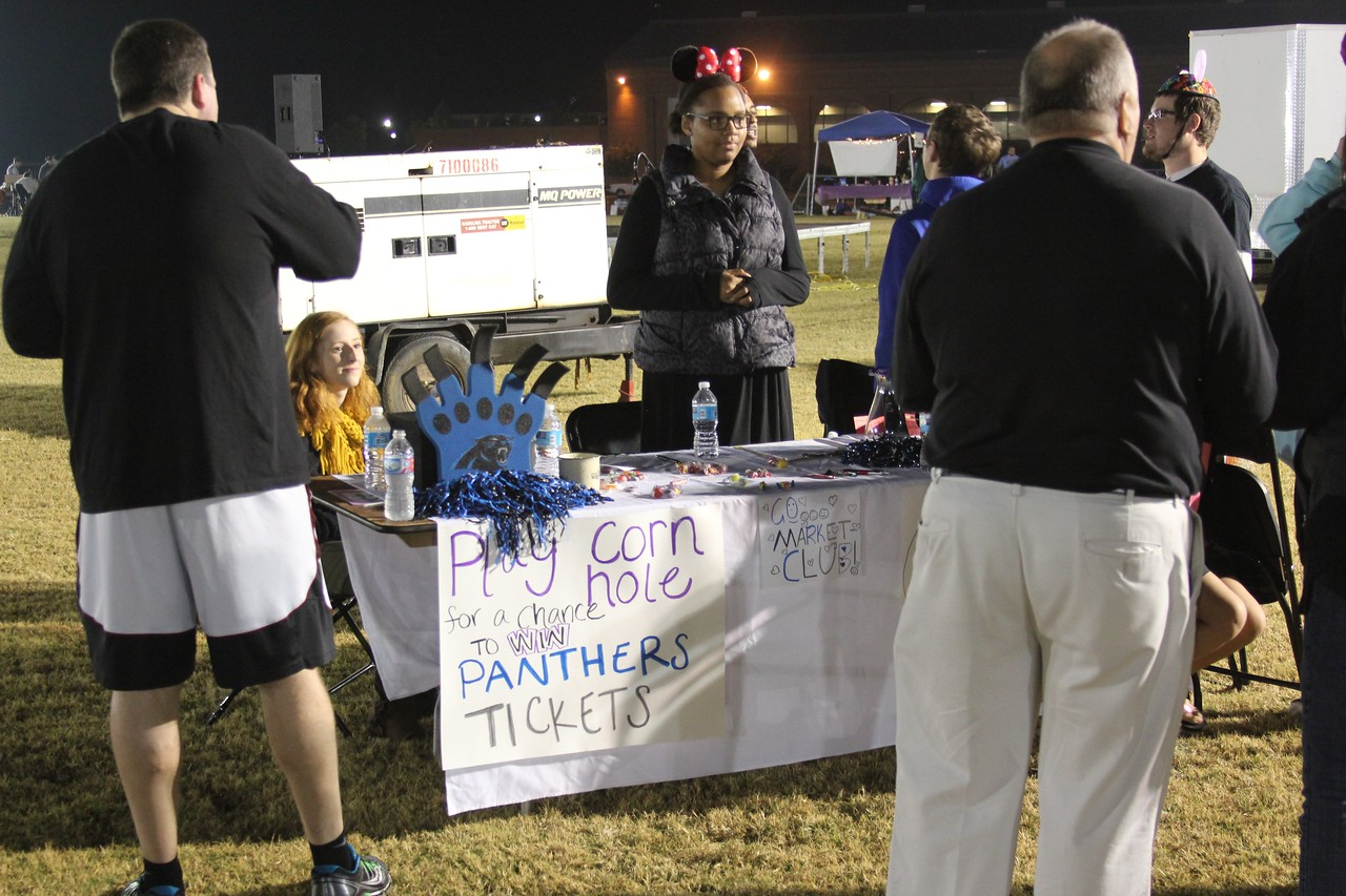 Corn hole players had opportunities to win Panther's Tickets at the Marketing Club's booth