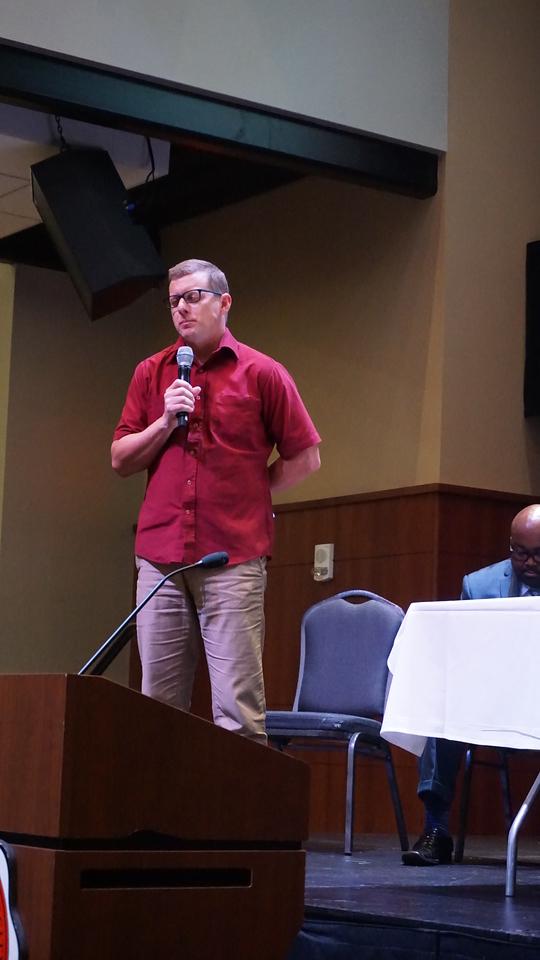 Local Pastor Matt Orth offers a prayer at the Transcending Boundaries Symposium.