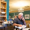 JOED VIERA/STAFF PHOTOGRAPHER-Lockport, NY-Bob Cammarata answers the phone at Cammarata's Restaurant.