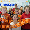 JOED VIERA/STAFF Lockport, NY-Emett Belknap Students wrap themselves in a anti-bullying chain at the school. The school held a end of bullying poster contest.