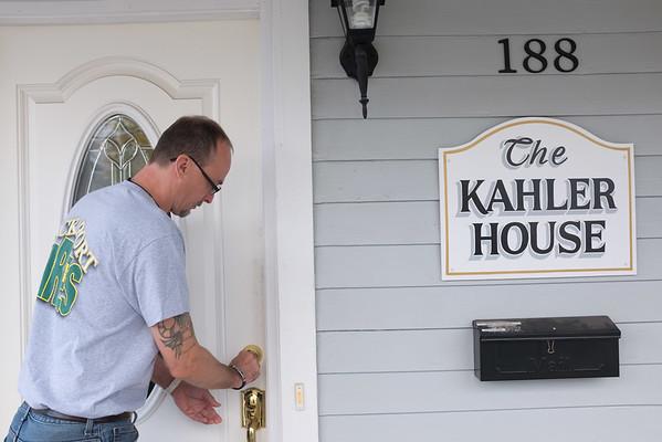 JOED VIERA/STAFF Lockport, NY-Doug Carnes Jr. opens Lockport CARES's Kahler House.
